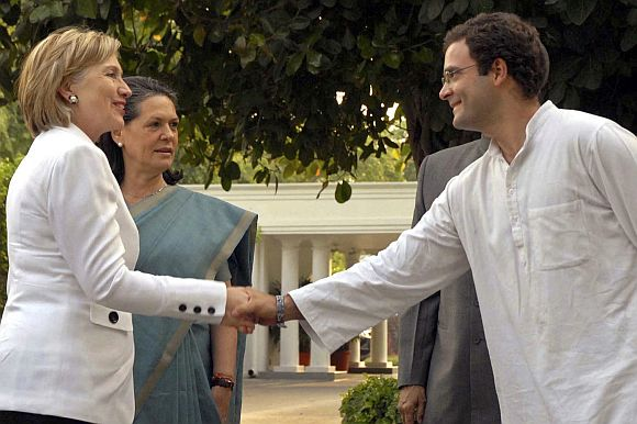 Then US secretary of state Hillary Clinton greets Rahul Gandhi in New Delhi, July 2009, as Sonia Gandhi looks on.
