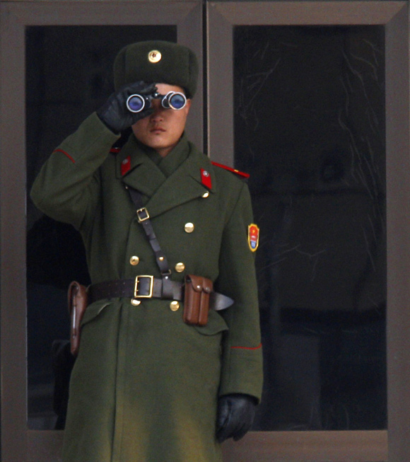 A North Korean soldier watches the South Korean side at the border village of Panmunjom in the DMZ