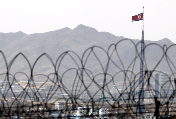 The North Korean flag flutters on top of a tower at the propaganda village of Gijungdong in the demilitarised zone