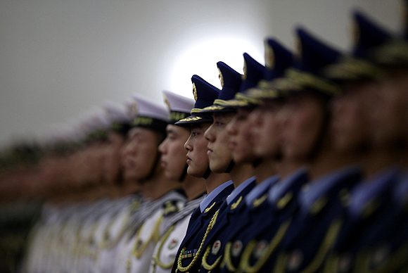 Members of an honour guard stand in formation ahead of a welcome ceremony in Beijing