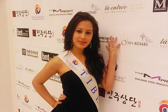 Miss Tibet 2011 Tenzin Yangkyi posing for the media in Incheon, South Korea