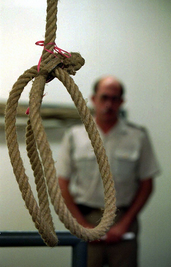 A prison guard looks over the hangman's noose at Pretoria's maximum security prison gallows