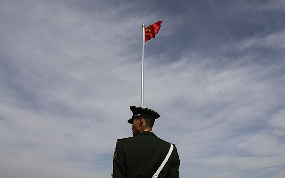 A paramilitary policeman stands guard at Tiananmen Square in Beijing