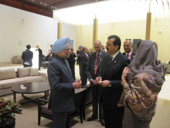 Prime Minister Manmohan Singh with Pakistan Prime Minister Yousaf Raza Gllani and Foreign Minister Hina Rabbani Khar at the Nuclear Security Summit in Seoul