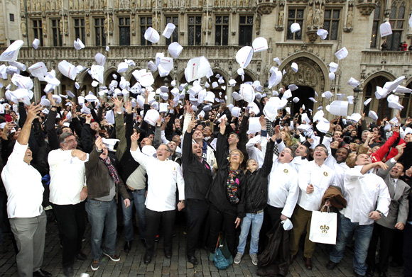 Largest gathering of people throwing chefs hats