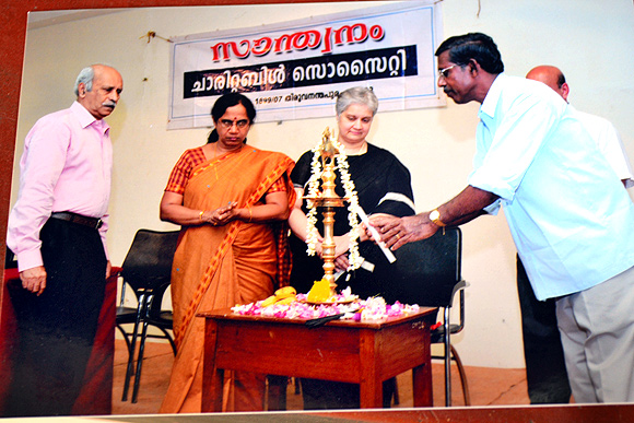 M S Mathews, president, Santhawnam Charitable Society; Sobha Koshy, Kerala's chief postmaster general, and S Babu at an event conducted by the Society