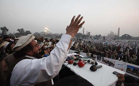 Hafiz Saeed speaks to gathering during an anti-American and Indian rally on the grounds of th