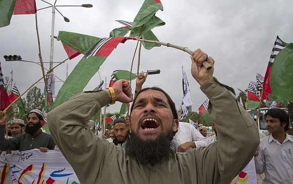 A supporter of religious political party Sunni Tehreek shouts anti-American slogans during a demonstration in Islamabad