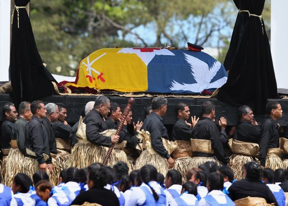 The late King George Tupou V is carried to the Royal Tomb during the state funeral held for King George Tupou V at Mala'ekula
