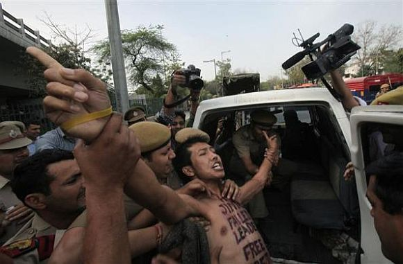 A Tibetan exile is detained by police during a protest against the visit of Chinese President Hu Jintao to India, outside the hotel where Hu is staying, in New Delhi