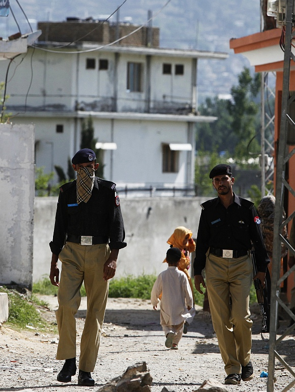 Policemen patrol a street near the compound where al Qaeda leader Osama bin Laden was killed in Abbottabad