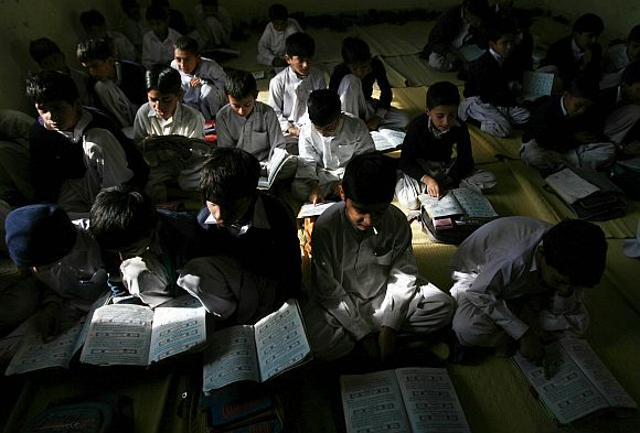 Students are pictured inside a classroom of a school in Jamaat-ud-Dawa charity's headquarters, known as the Markaz-e-Taiba in Muridke