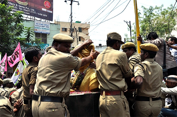 Police prevent protestors from vandalising a bust of Telugu Desam founder N T Rama Rao