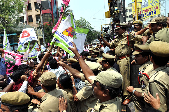 Police clash with demonstrators at a rally in Hyderabad