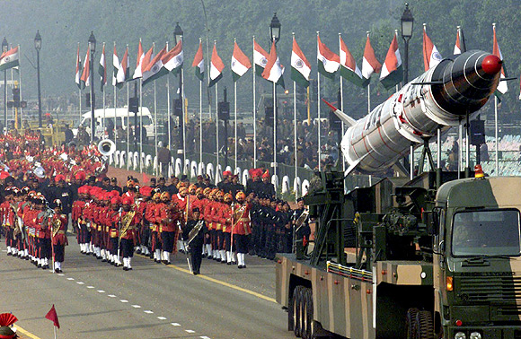Soldiers roll out the Agni missile during rehearsal for the Republic Day parade