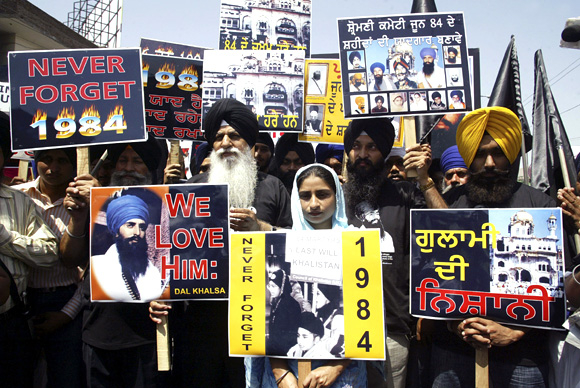 Activists from the Dal Khalsa hold placards during a rally against the 1984 riots
