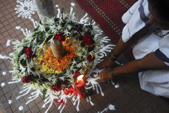 A woman offers prayers at a wreath laid in memory of the victims of the November 26, 2008 attacks in Mumbai