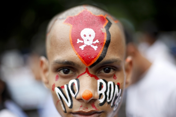 A student with a painted face participates in a peace rally in Mumbai