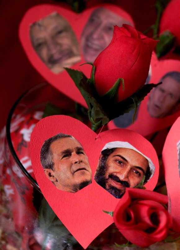 A bouquet of red roses shows pictures of George W Bush with Osama bin Laden in Amman