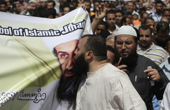 A man kisses a picture of Osama bin Laden during a protest in Cairo