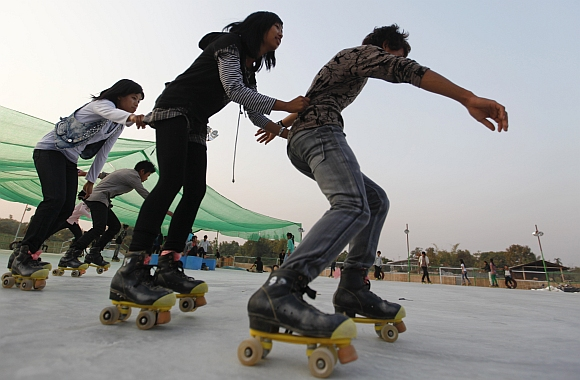 People rollerskate at a park in the city of Myitkyina in northern Myanmar.