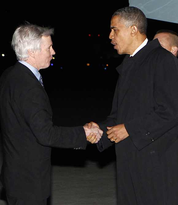 Obama shakes hands with US Ambassador to Afghanistan Crocker upon his arrival at Bagram Air Base in Kabul
