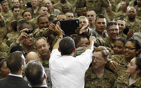 Obama greets troops at Bagram Air Base in Kabul