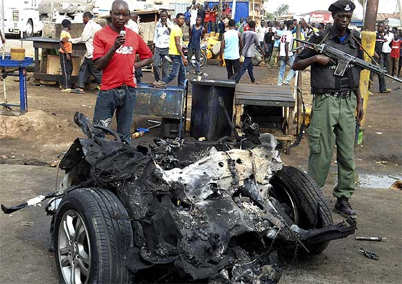 Part of a car used for detonating a bomb is seen at the scene of a blast, triggered by Boko Haram, in Nigeria's northern city of Kaduna