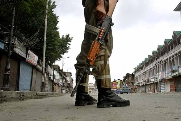 A soldier stands guard in Srinagar