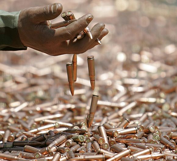 An army soldier displays seized bullets during a news conference in Jammu and Kashmir