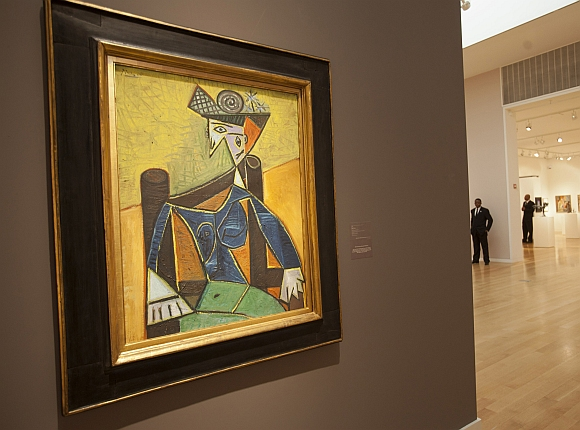 Guards stand near Pablo Picasso's painting