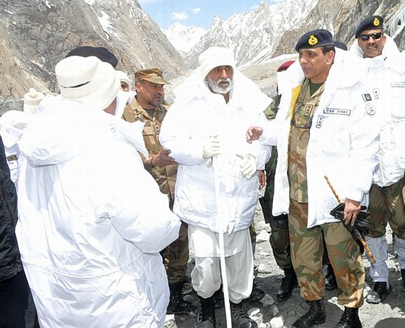 Pakistan Army Chief General Ashfaq Parvez Kayani during his visit to Gayari on Thursday with father of Major Zaka, who came under avalanche on April 7 2012