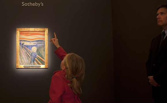 A girl looks over Munch's painting, part of a collection of Impressionist and Modern Art