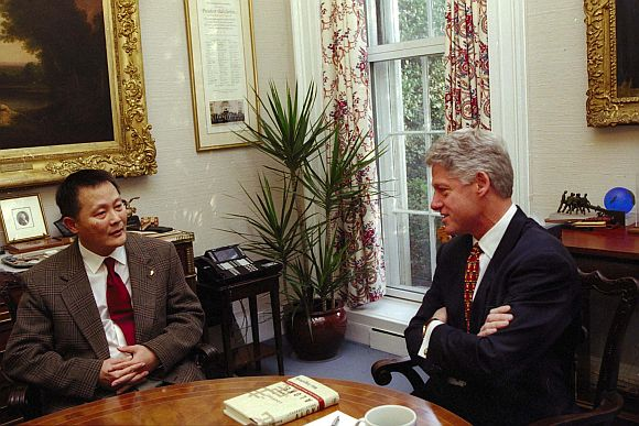 President Bill Clinton (Right) meets privately with Chinese dissident Wei Jingsheng, December 8 at the White House, in defiance of a Chinese appeal that US officials not meet him while he is in exile in America