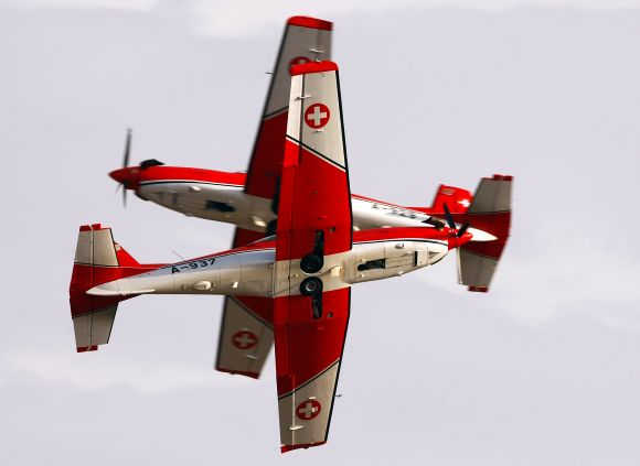 Two Pilatus PC-7 Turbo Trainer aircraft cross each other during the Malta airshow