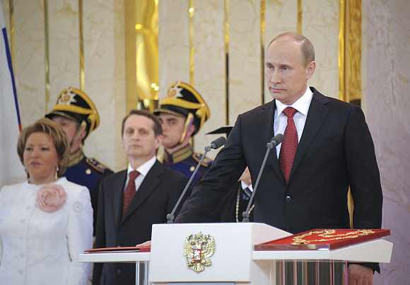 Vladimir Putin is sworn in as the new Russian president during a ceremony at the Kremlin in Moscow, May 7