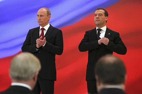 New Russian President Vladimir Putin and former President Dmitry Medvedev take part in an inauguration ceremony at the Kremlin in Moscow
