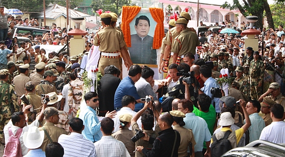 Supporters follow the body of Dorjee Khandu, the then Arunachal Pradesh CM, during a procession at Itanagar May 5, 2011