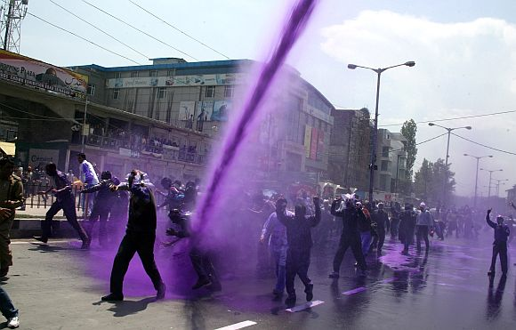 J&K police uses coloured water cannons on striking state government employees to foil their plan to gherao the civil secretariat, in Srinagar on Wednesday.