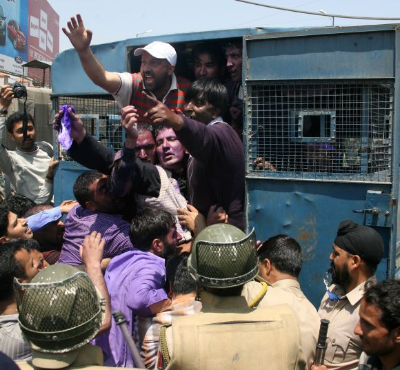 Police arrests some of the protesting J&K government employees, in Srinagar on Wednesday.