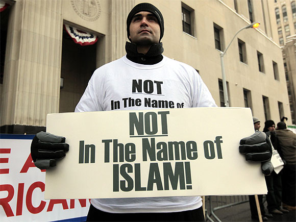 American Ali Sayed holds a sign in front of the Federal court building as he joins a demonstration against terrorism in Detroit