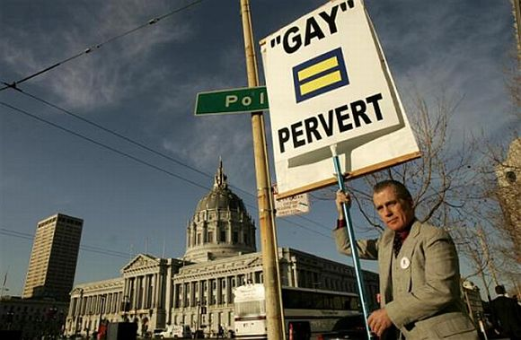 Don Grundmann, an opponent of gay marriage, carries a signboard outside the California supreme court