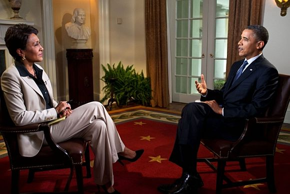 President Barack Obama participates in an interview with Robin Ro