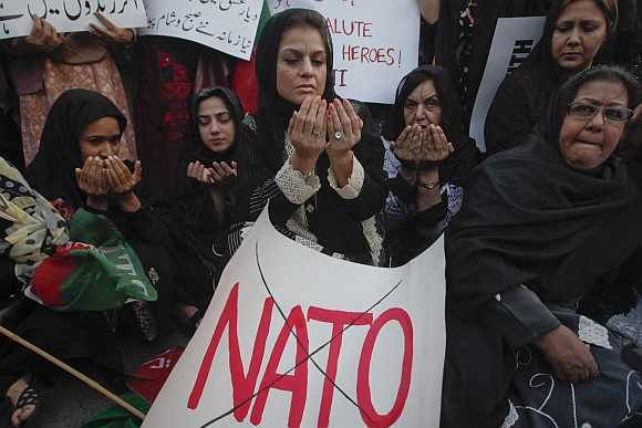 Supporters of Pakistan Tehreek-i-Insaf pray after a demonstration against NATO. US-Pak ties were hit after November's Nato strike