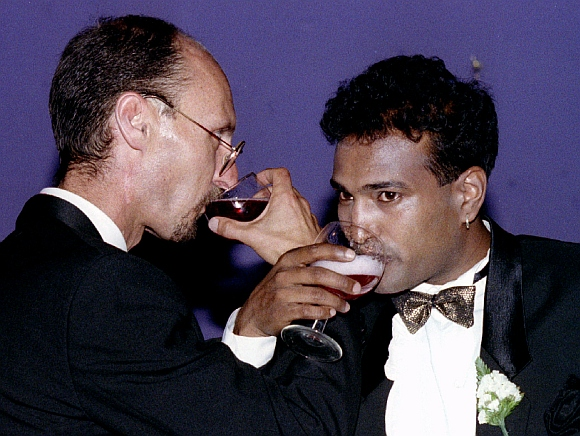Venash Mooriken (right) and Neil Millard drink a toast after taking their vows in the first cross-racial gay marriage of two HIV-positive men in South Africa
