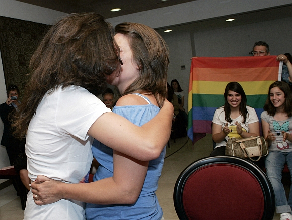 Teresa Paixao (left) and her partner Helena Pires kiss as they get married at a government's registry office in Lisbon