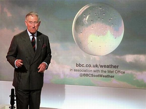 Prince Charles presents a special weather forecast during a visit to BBC Scotland's headquarters