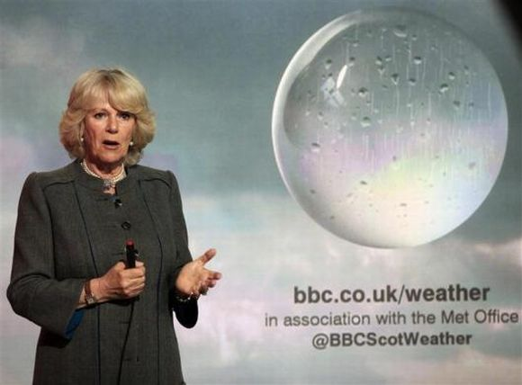 Camilla, Duchess of Cornwall presents a special weather forecast during a visit to BBC Scotland's headquarters in Glasgow