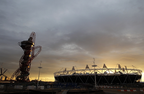 The sun sets behind the Olympic stadium and Anish Kapoor's ArcelorMittal Orbit tower in Stratford, east London