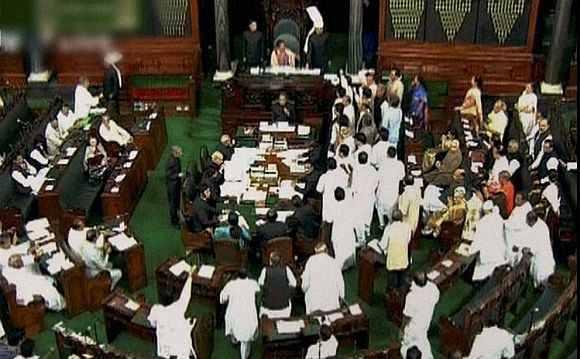 A video grab of a chaotic Lok Sabha session